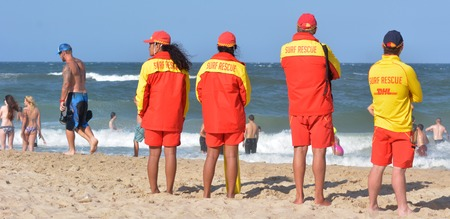 first australians: GOLD COAST, AUS - NOV 0 2014: Australian Lifeguards in Gold Coast Australia.Australian Lifeguards are world-renown for their high levels of skill and knowledge in accident prevention and rescue response