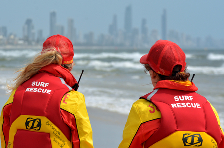 first australians: GOLD COAST, AUS - NOV 02 2014:Australian woman Lifeguards in Gold Coast Australia.They are world-renown for their high levels of skill and knowledge in accident prevention and rescue response