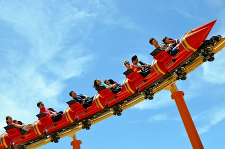 GOLD COAST, AUS -  NOV 06 2014:Visitors ride on Road Runner Roller Coaster in Movie World Gold Coast Australia.Its a 335-metre (1,099 ft) Junior Coaster reaches a top speed of 45.9 kmh (28.5 mph)