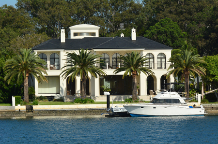 home prices: GOLD COAST - OCT 23 2014:Laxury houses in macintosh island. Australia central bank keeping a close eye on the property market amid a recent resurgence in home prices.
