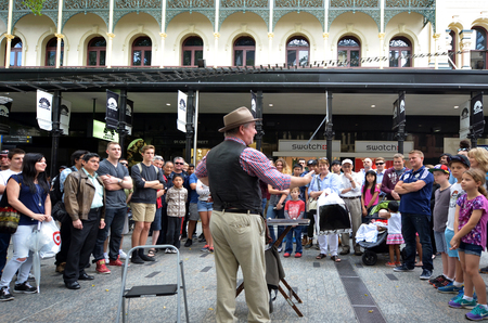 24 26: BRISBANE, AUS - SEP 24 2014:Street show at Queen Street Mall.It is a pedestrian mall with more than 700 retailers with six major shopping centres. It receives over 26 million visitors each year Editorial