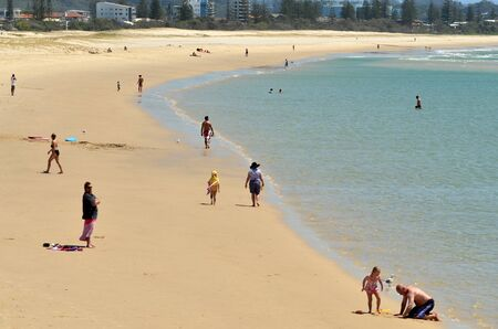 tourist destination: COOLANGATTA - OCT 07 2014:Visitors in Kirra beach.Coolangatta was one of the earliest settlements on the Gold Coast today its a very popular tourist destination in Australia. Editorial
