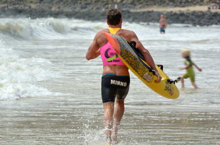 lifesaving: COOLANGATTA, AUS - NOV 2 2014:Josh Minogue  race in Coolangatta Gold 2014.He announced he would hang up Speedo after the 41.8-kilometre race but it turns to be its first win in the elite race.