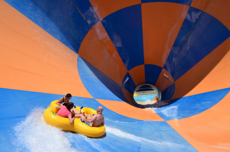 water park: GOLD COAST, AUS - OCT 30 2014:Visitors in WetnWild Gold Coast water park. In 2009, the park received 1,095,000 visitors ranking it first in Australia and eighth in the world