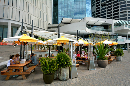 unrivaled: BRISBANE, AUS - SEP 25 2014:People dining in restaurant at Eagle Street Pier.It is an iconic waterfront precinct with world class dining options and unrivaled views of the Brisbane River.