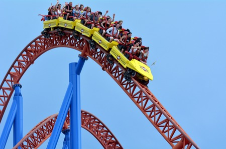 roller coaster: GOLD COAST, AUS -  NOV 06 2014:Visitors ride on Superman Escape in Movie World Gold Coast Queensland Australia.Its an Accelerator Coaster that accelerates from 0 to 100 Km per hour (62 mph) in 2 sec. Editorial