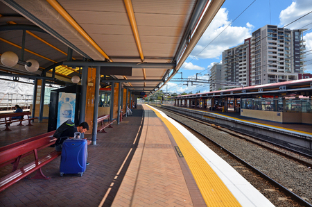 goldcoast: BRISBANE, AUS - SEP 26 2014:Passangers in Roma Street railway station. Roma Street is a heritage-listed major railway station in the CBD of Brisbane, Australia.
