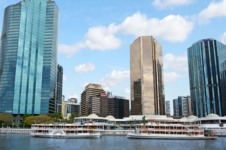 unrivaled: BRISBANE, AUS - SEP 25 2014:Riverboats mooring at Eagle Street Pier.It is an iconic waterfront precinct with world class dining options and unrivaled views of the Brisbane River.