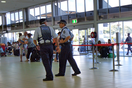 security uniform: COOLANGATTA, AUS - SEP 25 2014:Police officers in Coolangatta Airport.Gold Coast police on high terror alert warned to be hyper vigilant and patrol local mosques and critical infrastructure sites
