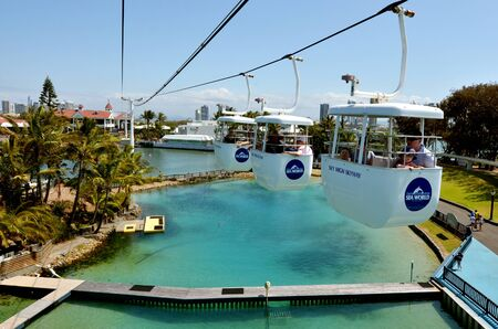 sea world: GOLD COAST, AUS -  NOV 06 2014:Visitors ride on Sky High Skyway in Sea World Gold Coast Australia.Its sea animals theme park that promote conservation education of sea and marine wildlife.