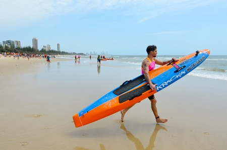 coolangatta: GOLD COAST, AUS - NOV 2 2014:Caine Eckstein race in Coolangatta Gold 2014.The five-time Gold champion Caine Eckstein was forced out of the race due to the pain of a torn bicep around 30km into the event. Editorial