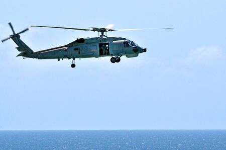 ideally: GOLD COAST, AUS - NOV 10 2014:Australian sea search and rescue helicopter.Black Hawk is a multi-role helicopter ideally suited to its primary role of providing air mobility for troops and equipment in the battle zone. Editorial