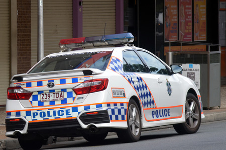 police: BRISBANE, AUS - SEP 25 2014:Queensland Police car patrol.Gold Coast police on high terror alert warned to be hyper vigilant and patrol local mosques and critical infrastructure sites