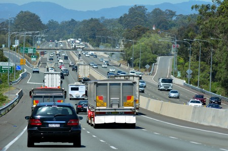 scenic highway: GOLD COAST - OCT 07 2014:Traffic on Pacific Highway..The Pacific Highway is a major transport route along part of the east coast of Australia and one of the busiest highways in Australia.