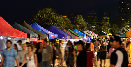 beachfront: SURFERS PARADISE AUS - OCT 29 2014:Visitors in Surfers Paradise Beachfront Markets.Its the largest Night Market in Gold Coast Queensland, Australia.It feature a variety of local tourism products. Editorial