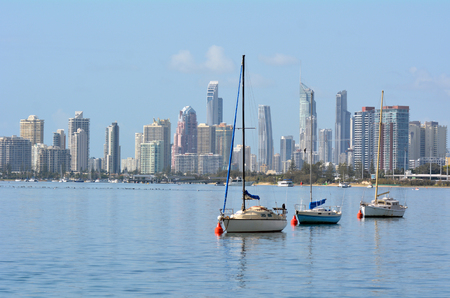 surfers paradise: GOLD COAST - SEP 27 2014:Yachts mooring under Surfers Paradise Skyline.It one of Australias iconic coastal tourist destinations, drawing about 10 million tourists every year from all over the world.