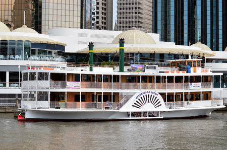 unrivaled: BRISBANE, AUS - SEP 25 2014:Riverboat mooring at Eagle Street Pier.It is an iconic waterfront precinct with world class dining options and unrivaled views of the Brisbane River.