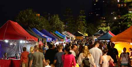 night market: SURFERS PARADISE AUS - OCT 29 2014:Visitors in Surfers Paradise Beachfront Markets.Its the largest Night Market in Gold Coast Queensland, Australia.It feature a variety of local tourism products. Editorial