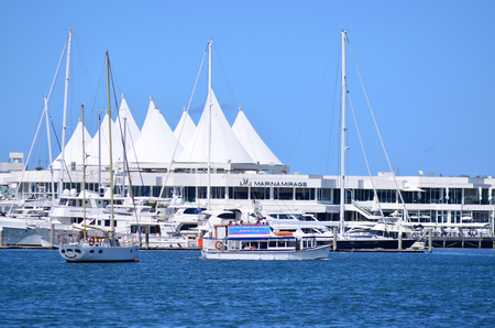 super yacht: GOLD COAST - OCT 16 2014:Marina Mirage Shopping Center.Its Queenslands finest waterfront shopping and dining resort with award winning restaurants, designer boutiques of worlds top fashion labels