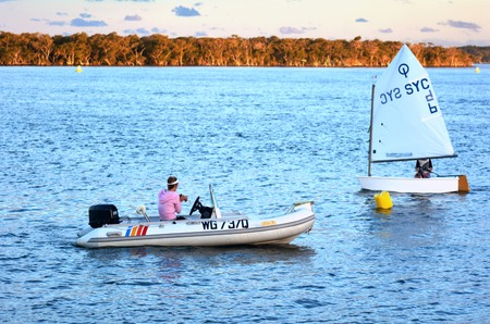 waterways: GOLD COAST - OCT 16 2014:Australian youth learns to sail. With 9 times more waterways than Venice, the Gold Coast is a boating paradise with over 260 kilometers of navigable waterways within the city.