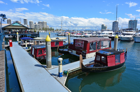 tourist destination: GOLD COAST - OCT 16 2014:Italian gondolas in Mariners Cove.Its a popular tourist destination for water sports and activities in Gold Coast Queensland Australia