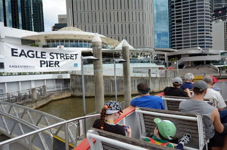 devastating: BRISBANE, AUS - SEP 25 2014:Visitors sail on CityFerry at Eagle Street Pier ferry wharf in Brisbane, Australia.In January 2011 it sustained damage during the devastating floods and it was repaired and reopened on 14 February 2011.