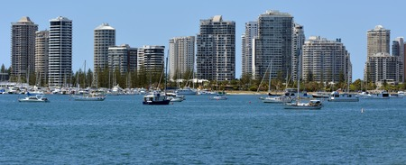 surfers paradise: GOLD COAST - OCT 23 2014:Yachts mooring under Surfers Paradise Skyline.It one of Australias iconic coastal tourist destinations, drawing about 10 million tourists every year from all over the world.