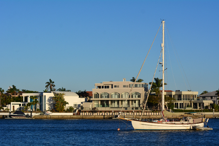 riverside county: GOLD COAST - OCT 14 2014:Luxury homes and yacht in Sovereign Islands.Its one of the most expensive areas in Gold Coast Queensland and Australia with some homes in excess of 20 million dollars.