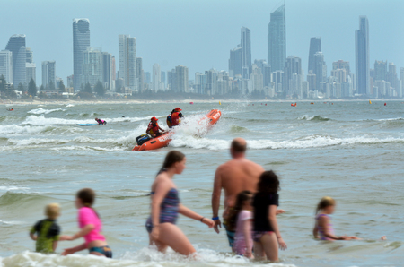 first australians: GOLD COAST, AUS - NOV 02 2014:Australian Lifeguards in action.They are world-renown for their high levels of skill and knowledge in accident prevention and rescue response Editorial