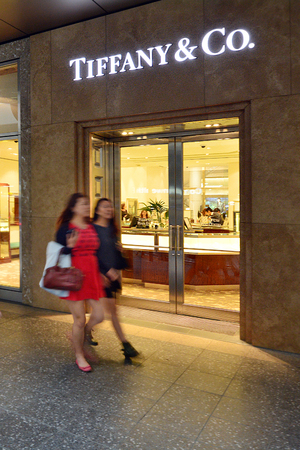 retailer: BRISBANE, AUS - SEP 25 2014:People passing by Tiffany & Co Store in Queens street mall.It is an American multinational luxury jewelry and specialty retailer founded at 1837. Editorial