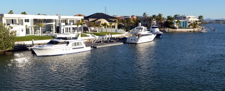 riverside county: GOLD COAST - OCT 14 2014:Luxury homes and super yachts in Sovereign Islands.Its one of the most expensive areas in Gold Coast Queensland and Australia with some homes in excess of 20 million dollars. Editorial