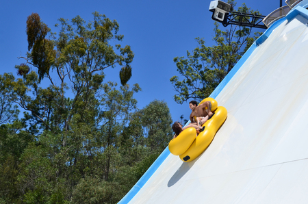 water park: GOLD COAST, AUS - OCT 30 2014:Visitors rids on Kamikaze in WetnWild Gold Coast water park. In 2009, the park received 1,095,000 visitors ranking it first in Australia and eighth in the world