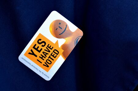 election commission: MANGONUI, NZL -SEP 20 2014:I HAVE VOTED sticker OF NZ 2014 General Election.The Electoral Commission said 717,579 people voted in advance of election day, more than double then Election in 2011.