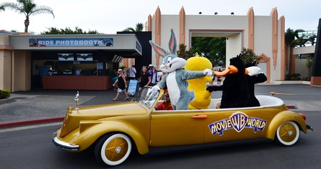bugs bunny: GOLD COAST, AUS -  NOV 06 2014:Bugs Bunny and animated cartoon characters in Movie World Gold Coast Queensland Australia.The park opened in 1991 and contains various movie-themed rides and attractions