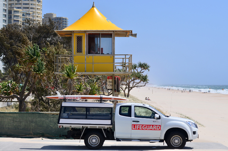 surfers paradise: SURFERS PARADISE, AUS - OCT 28 2014:Australian Lifeguards on alert. Australian Lifeguards are world-renown for their high levels of skill and knowledge in accident prevention and rescue response Editorial