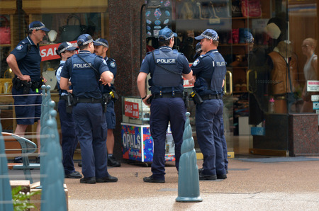 police force: GOLD COAST, AUS - NOV 02 2014:Police officers patrols in Surfers Paradise. Gold Coast police on high terror alert warned to be hyper vigilant and patrol local mosques and critical infrastructure sites Editorial