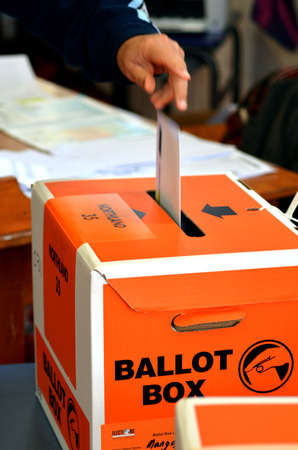 voted: MANGONUI, NZL -SEP 20 2014:New Zelanders voting for NZ 2014 General Election.The Electoral Commission said 717,579 people voted in advance of election day, more than double then Election in 2011.