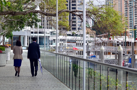 BRISBANE, AUS - SEP 25 2014:Couple walks towards Eagle Street Pier.It is an iconic waterfront precinct with world class dining options and unrivaled views of the Brisbane River. Editorial