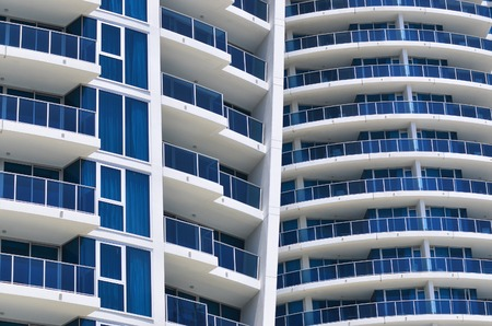 property owners: GOLD COAST - SEP 28 2014:Apartments building.Australia Reserve Bank has sent out warning to Australian property owners that it needs to take measures to control the booming housing market Editorial