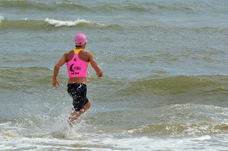 coolangatta: GOLD COAST, AUS - NOV 2 2014:Man race in Coolangatta Gold 2014.The Coolangatta Gold is the toughest race in ironman, and one of the toughest in world sport. Editorial