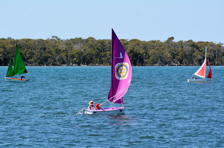 waterways: GOLD COAST - SEP 30 2014:People sail a a dingy. With nine times more waterways than Venice, the Gold Coast is a boating paradise with over 260 kilometers of navigable waterways within the city. Editorial