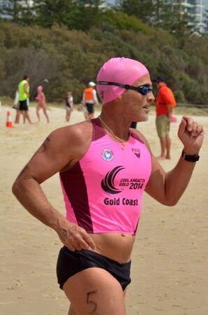 coolangatta: COOLANGATTA - NOV 2 2014:Grant Kenny race in Coolangatta Gold 2014.The 51 years old legend Ironman won in 1980 both the Australian Junior and Open Iron Man Championship on the same day.