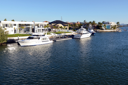 million dollars: GOLD COAST - OCT 14 2014:Luxury homes and super yachts in Sovereign Islands.Its one of the most expensive areas in Gold Coast Queensland and Australia with some homes in excess of 20 million dollars. Editorial
