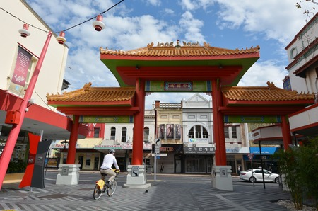 fortitude: BRISBANE, AUS - SEP 25 2014:Man cycle in Chinatown Brisbane, Queensland Australia.Chinatown in Brisbanes Fortitude Valley is a popular location for food, markets and entertainment.