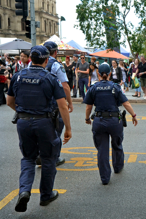 warned: BRISBANE, AUS - SEP 25 2014:Queensland police officers patrol.Gold Coast police on high terror alert warned to be hyper vigilant and patrol local mosques and critical infrastructure sites
