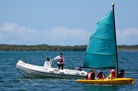 waterways: GOLD COAST - SEP 30 2014:Australian youth learns to sail. With 9 times more waterways than Venice, the Gold Coast is a boating paradise with over 260 kilometers of navigable waterways within the city.