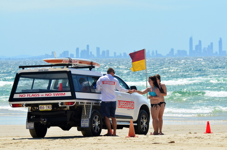 first australians: COOLANGATTA - OCT 07 2014: Australian Lifeguards in Gold Coast Australia.Australian Lifeguards are world-renown for their high levels of skill and knowledge in accident prevention and rescue response Editorial