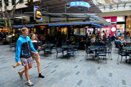 urban centers: BRISBANE, AUS - SEP 25 2014:Visitors at Queen Street Mall.It is a pedestrian mall with more than 700 retailers with six major shopping centres. It receives over 26 million visitors each year
