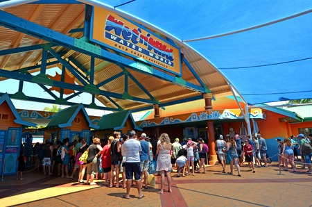 water park: GOLD COAST, AUS - OCT 30 2014:Visitors get in to WetnWild Gold Coast water park. In 2009, the park received 1,095,000 visitors ranking it first in Australia and eighth in the world