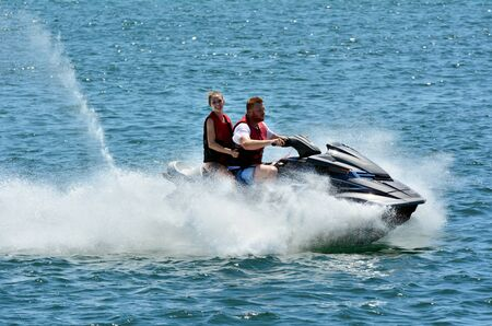 personal watercraft: GOLD COAST, AUS - OCT 29 2014:People rid on water scooter.According to U.S. Coast Guard statistics, 212 injuries tallied in 238 accidents. In 2011, some 44 people were killed on personal watercrafts.